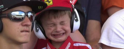 A Ferrari fan cries as Kimi Raikkonen crashes out