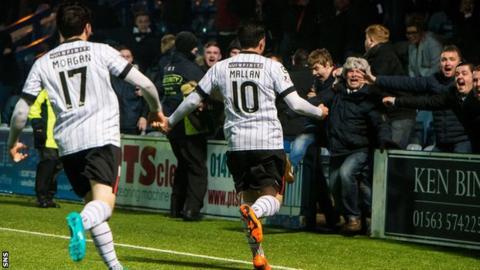 Stephen Mallan celebrates scoring