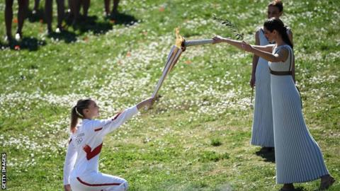 Greece's Anna Korakaki receives the Olympic flame