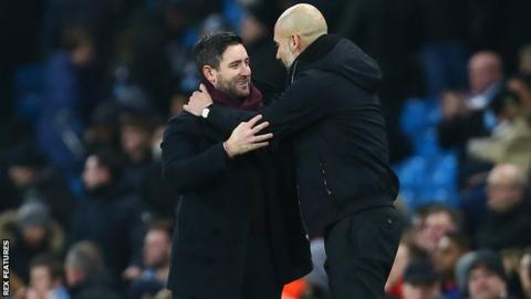 Bristol City boss Lee Johnson and Manchester City's Pep Guardiola