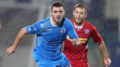 Chris Ramsey battles with Cliftonville's James Knowles last year