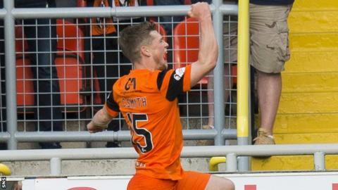 Cammy Smith celebrates his opening goal for Dundee United