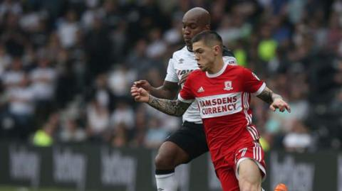 Middlesbrough's Muhamed Besic fights for possession with Andre Wisdom of Derby County