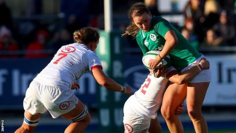 Michelle Claffey of Ireland and USA try-scorer Kimber Rozier in action at Energia Park
