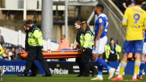 Maikel Kieftenbeld is stretchered off the field after suffering the knee injury in the second half of Birmingham City's win against Leeds United