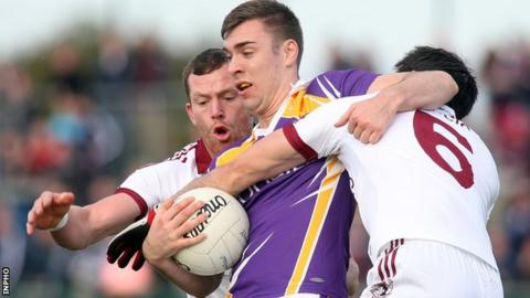 Slaughtneil pair Patsy Bradley and Chrissy McKaigue tackle Derrygonnelly's Connall Jones