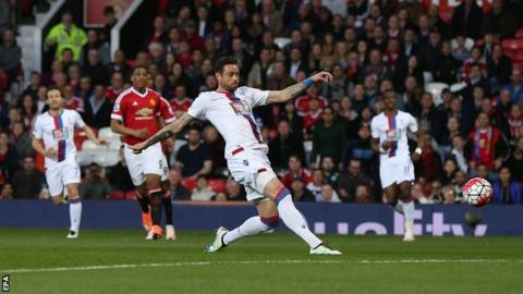 Damien Delaney scores an own goal against Manchester United