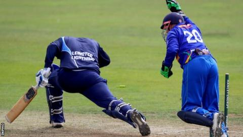 Leinster batsman Gareth Delaney is stumped by Niall O'Brien in the Leinster CC game