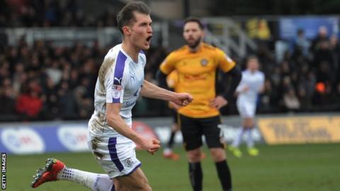 Luton's Dan Potts celebrates a goal