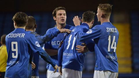 Glenavon players congratulate Andy Hall after his free-kick earns them a 1-1 draw against struggling Warrenpoint Town