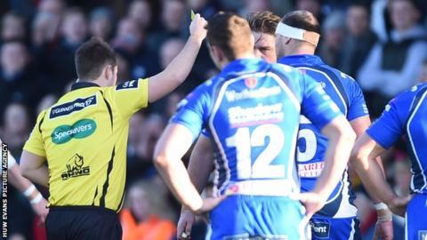 Referee Ben Whitehouse shows a yellow card to Newport Gwent Dragons lock Rynard Landman
