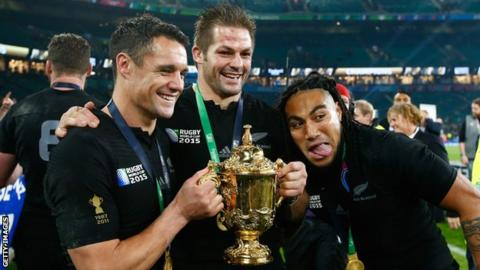 Dan Carter (left) celebrates winning the 2015 Rugby World Cup with New Zealand team-mates Richie McCaw and Ma'a Nonu
