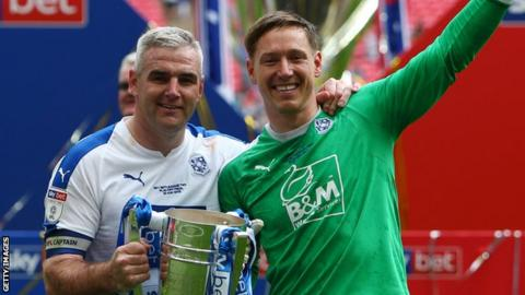 Scott Davies (right) helped Tranmere Rovers to successive promotions from the National League to League One