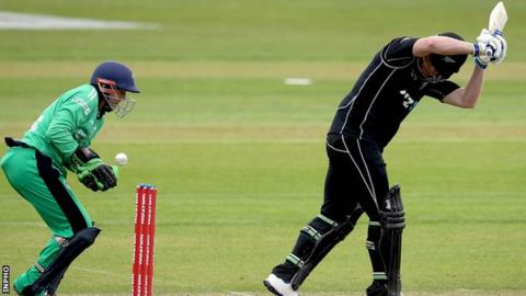 Ireland wicketkeeper Niall O'Brien attempts to collect the ball as Jimmy Neesham lets a delivery pass