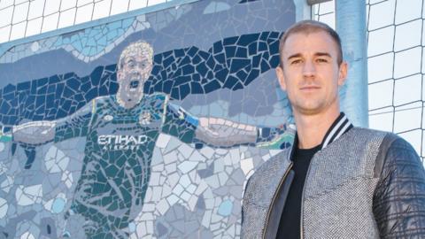 Joe Hart stands by his mosaic