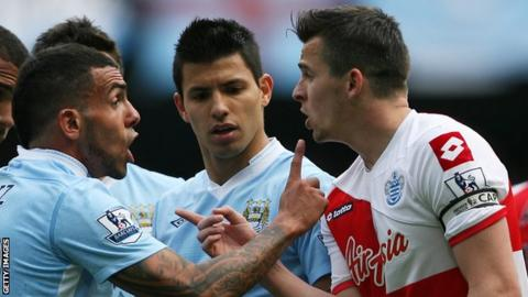 Joey Barton argues with Carlos Tevez in 2012