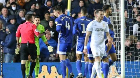 Cardiff City players react to Sean Morrison's red card at Leeds