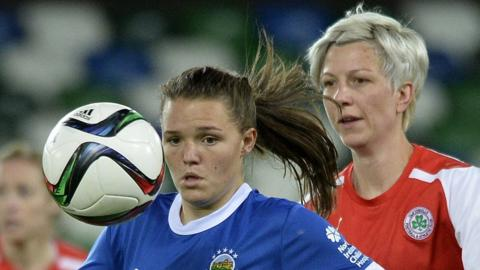 Abbie Magee of Linfield comes under pressure from Cliftonville's Terri Moore during the women's cup final