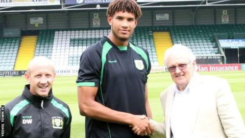 Yeovil manager Darren Way (left) and chairman John Fry shake on the deal with Omar Sowunmi