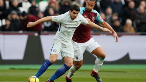 Winston Reid (right) tangles with Chelsea's Alvaro Morata