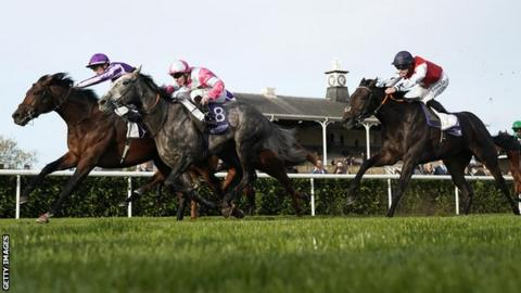 Magna Grecia (left) holds off Phoenix of Spain to win at Doncaster