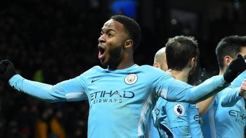 Raheem Sterling celebrates Man City's derby win