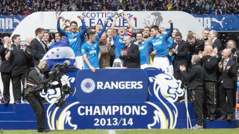 Skipper Lee McCulloch lifts the League One trophy as Rangers go through the entire campaign without losing a match.