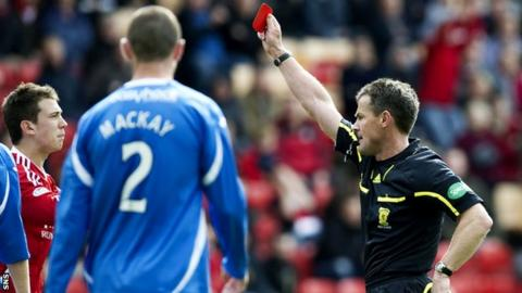 Steve Conroy shows the red card