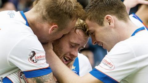 Kilmarnock's Rory McKenzie (centre) celebrates his goal after his cross was deflected into the net