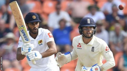 Sri Lanka batsman Roshen Silva watches the ball after playing a shot, with England wicketkeeper Ben Foakes behind him