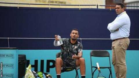 Kyrgios talks to a match official