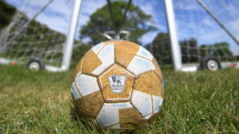 A football with the logo of the English Premier League at the training complex of Watford