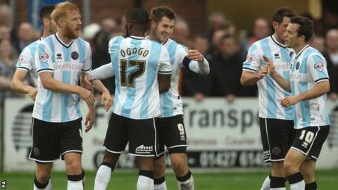 Shrewsbury striker James Collins celebrates his FA Cup winner at Gainsborough