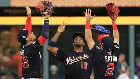 Washington Nationals players Juan Soto (left), Victor Robles (centre) and Adam Eaton (right) celebrate after beating Houston Astros in game one of the World Series
