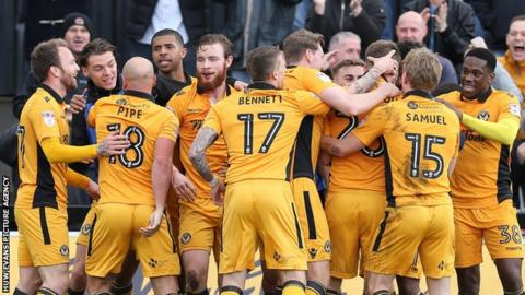 Newport County players celebrate Mickey Demetriou's winner against Crawley