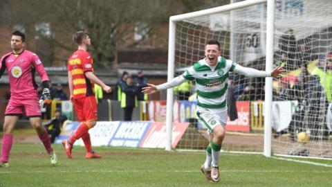 Callum McGregor runs off to celebrate Celtic's second goal