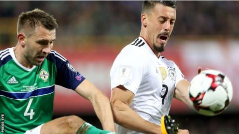 Northern Ireland defender Gareth McAuley in action against Sandro Wagner of Germany