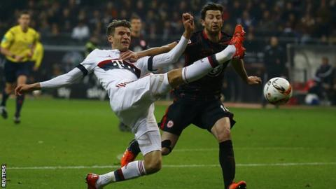 Bayern's Thomas Muller battles for possession with Eintracht Frankfurt's Abraham
