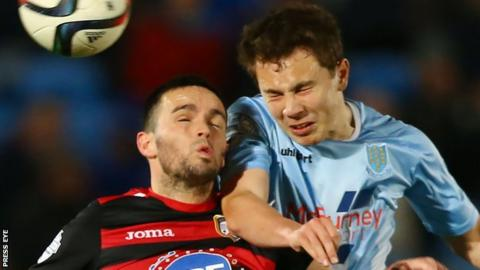 Coleraine's Neil McCafferty competes against Eoin Kane of Ballymena