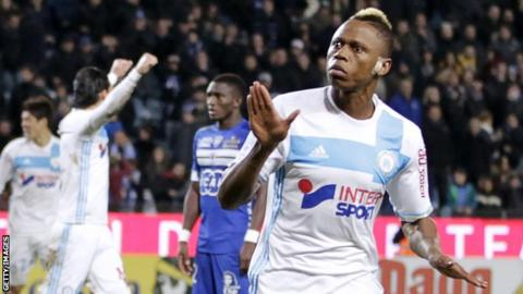 Clinton Njie celebrates scoring for Marseille