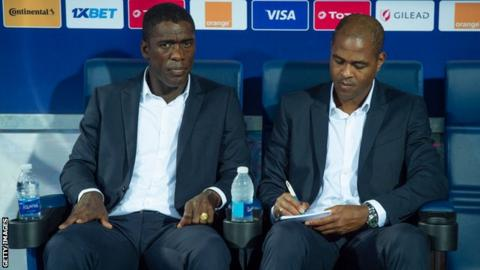 Cameroon head coach Clarence Seedorf (left) and assistant Patrick Kluivert
