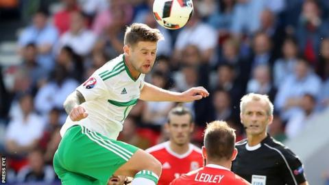 Oliver Norwood sends in a header against Wales in the Euro 2016 finals