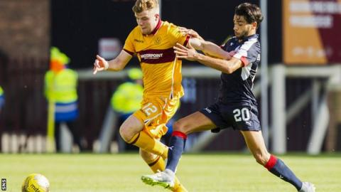 Motherwell's Chris Cadden is tackled by Dundee striker Faissal El Bakhtaoui