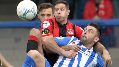 Sean Wards outmuscles Coleraine striker Eoin Bradley in a tussle for the ball