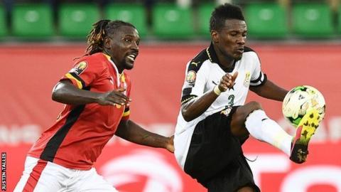 Asamoah Gyan (right)