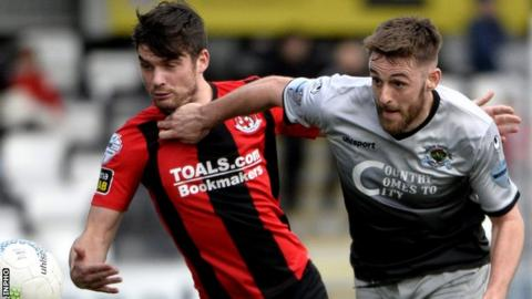 Philip Lowry of Crusaders in action against Institute's Niall Grace