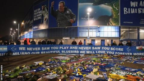 Tributes to striker Emiliano Sala have been laid by supporters at Cardiff City Stadium