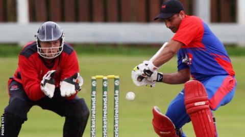 Waringstown wicketkeeper Marcus McLean is ready to snap up a chance as Waqar Azmat bats for Clontarf in the T20 final