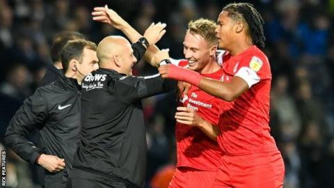 Two-goal Barnsley hero Cauley Woodrow (right centre) went to celebrate his opening strike at The Hawthorns with caretaker boss Adam Murray