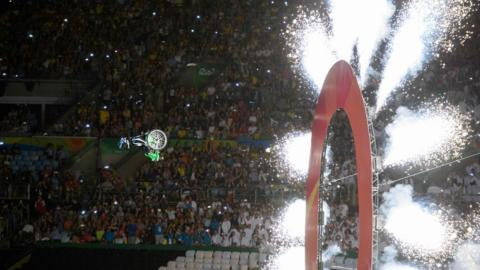 Aaron 'Wheelz' Fotheringham, an extreme wheelchair athlete, flies through the air at the Paralympic opening ceremony